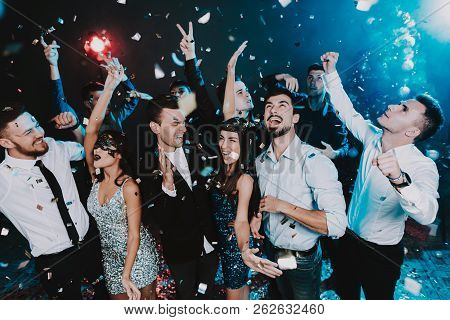 Smiling People Celebrating New Year On Party. Happy New Year. People Have Fun. Indoor Party. Celebra