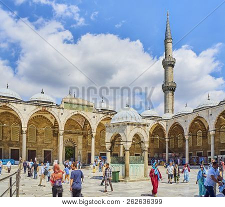 Istanbul, Turkey - July 7, 2018. Tourists Walking In The Courtyard Of The Sultan Ahmet Camii Mosque,