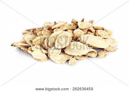 Chinese Herbal Medicine - Astragalus Slices, Huang Qi (astragalus Propinquus) On White Background (m