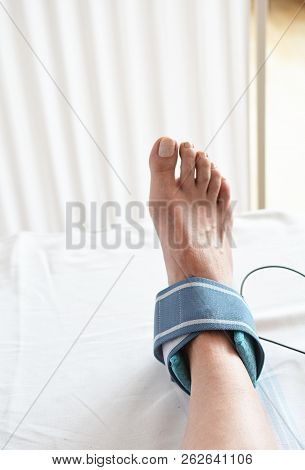 woman ankle sprain and electrotherapy in the hospital poster