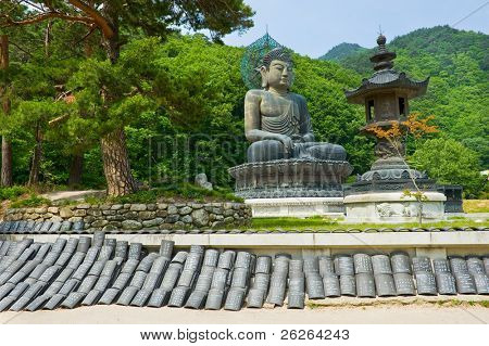 Giant statue of Buddha and memorial plates in the Sinheungsa Temple in Seoraksan National Park, South korea