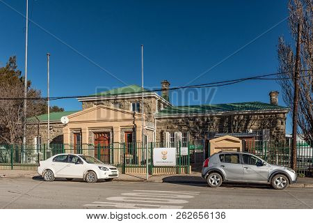 Sutherland, South Africa, August 8, 2018: A Street Scene, With The Magistrates Court And Vehicles, I