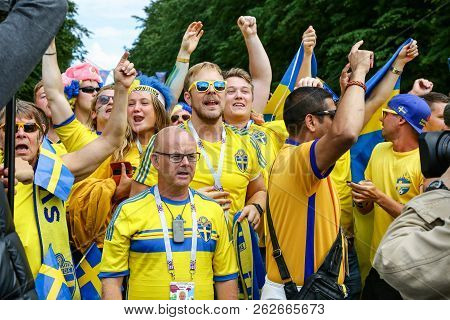 St. Petersburg, Russia - July 3, 2018: Swedish Fans Parade. Crowd Of Supporters Of Sweden National F