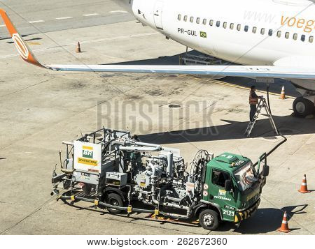 Guarulhos, Sao Paulo, Brazil, August 14, 2018. Fuel Truck Fuels An Aircraft At Andre Franco Montoro