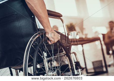 Close Up. Disabled Man On Wheelchair In Office. Disabled Young Man. Man On Wheelchair. Recovery And