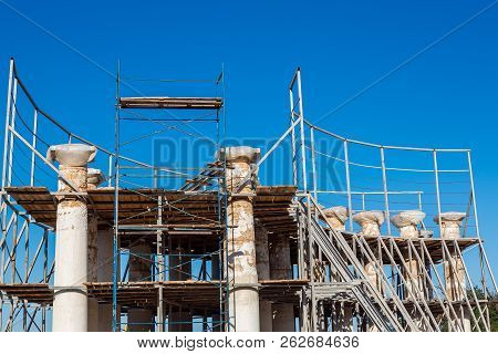 Reconstruction Of Ancient Historical Colonnades, Colons From A Stone Shell Rock Restore The Former H