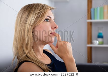 Close-up Of A Beautiful Young Contemplated Woman