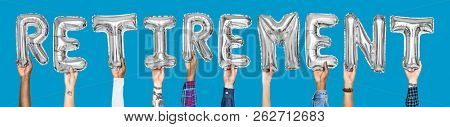 Silver gray alphabet balloons forming the word retirement