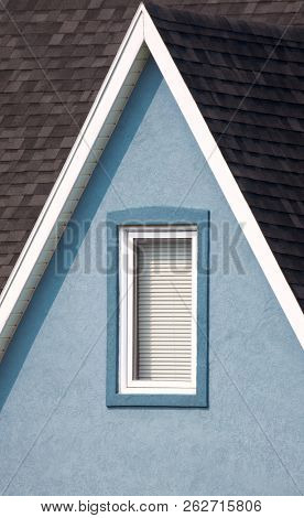 Grey roof, blue walls with window and white paintwork details. Minimalistic style.