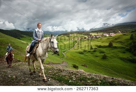 Horseback Riding On The Background Of The Mountain Village Of Shenako In The Province Of Tushetiya,
