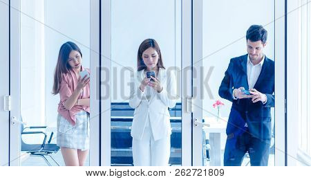 Team Of Young Business Man And Woman Stading In Meetin Room Windows