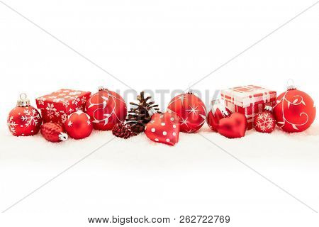 Christmas background decoration in red with gift and many christmas baubles