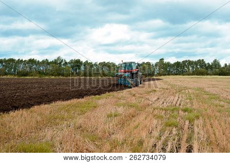 Tractor Plowing The Ground. Farmer Working In Field. Cultivation Of Land. Arable Land. Agricultural