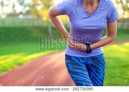 Side Stitch - Woman Runner Side Cramps After Running. Jogging Woman With Stomach Side Pain After Jog