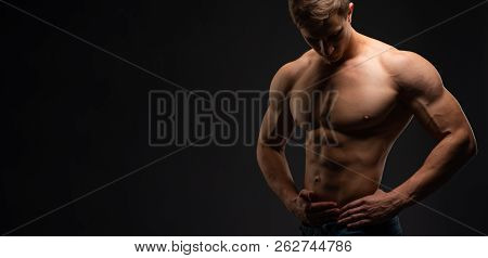 Bodybuilding Concept. Strong Bodybuilder Sports Fitness Man After Bodybuilding Training, Copy Space.
