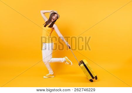 Traveler Tourist Woman In Summer Casual Clothes, Hat With Suitcase Isolated On Yellow Orange Backgro