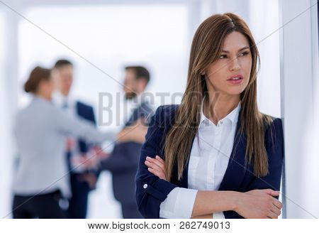 pensive business woman on blurred office background