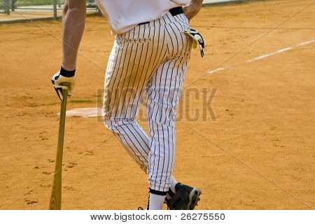 A player on deck waiting to bat