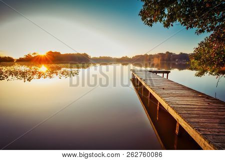 Sunrise On The Pier At Lake Bradford In Little Creek, Virginia.
