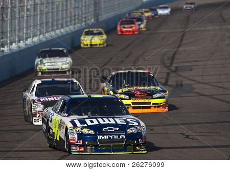 AVONDALE, AZ - Apr 10: Jimmie Johnson heads to turn one for the running of the Subway Fresh Fit 600 race at the Phoenix International Raceway April 10, 2010 in Avondale, AZ.