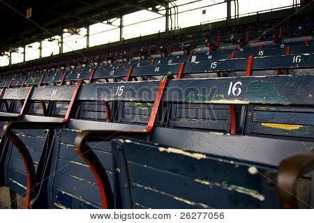 Rows of empty seats in a ballfield poster