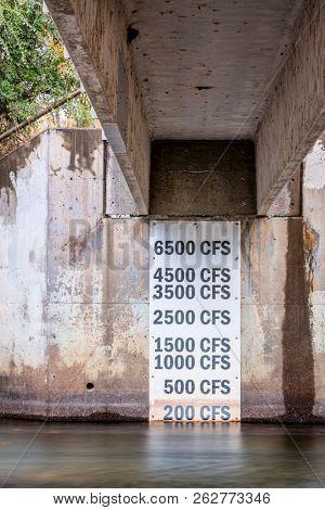 Measurement gauge marker for river water level under footbridge - Poudre River in Fort Collins, Colorado
