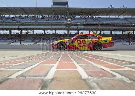 INDIANAPOLIS, IN - JULY 23:  Kevin Harvick brings his Shell Chevrolet down pit road for the Brickyard 400 race at the Indianapolis Motor Speedway on July 23, 2010 in Indianapolis, IN.