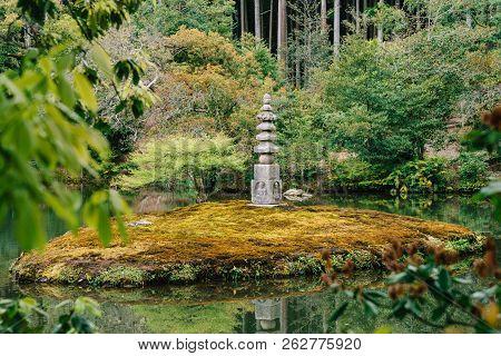 Japanese Stone Lantern Standing In Pond