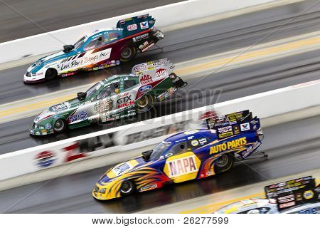 CONCORD, NC - MAR 28:  Tim Wilkerson, John Froce, Ron Capps, and Jack Beckman bring their Funny Cars down the track at the zMax Dragway for the Four-Wide Nationals in Concord, NC on Mar 28, 2010
