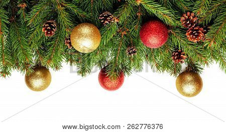 Christmas Tree Branches With Pine Cones And Christmas Balls As Decoration On White Background As A B