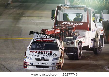 HAMPTON, GA - SEP 05:  Denny Hamlin's Toyota gets towed back in the garage area after blowing up during the Emory Healthcare 500 race at the Atlanta Motor Speedway in Hampton, GA on Sep 05, 2010