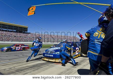 KANSAS CITY, KS - OCT 03:  Kurt Busch brings his Miller Lite Dodge in for service during the Price Chopper 400 race on October 3, 2010 at the Kansas Speedway in Kansas City, KS.