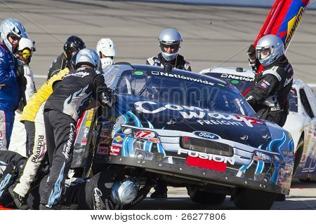 KANSAS CITY, KS - OCT 02:  Trevor Bayne brings in his Con-way Freight Ford Fusion in for service on October 2, 2010 during the Kansas Lottery 300 race at the Kansas Speedway in Kansas City, KS.