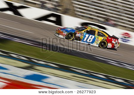 FORT WORTH, TX - NOV 06:  Kyle Busch brings his car through the frontstretch during a practice session for the AAA Texas 500 race on Nov 6, 2010 at the Texas Motor Speedway in Fort Worth, TX.