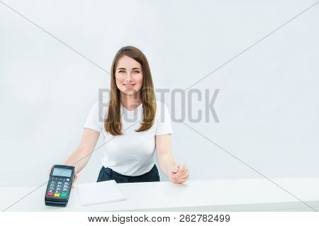 Administrative Manager Or Seller Holding Payment Terminal At Reception Desk. Contactless Payment Wit