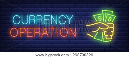 Currency operations neon sign. Hand grasping dollars. Profit, benefit, cash. Night bright advertisement. Vector illustration in neon style for banking, finance, business poster
