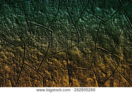 Textured Plaster Wall Background. Dark Turquoise And Golden Orange Color Transitions