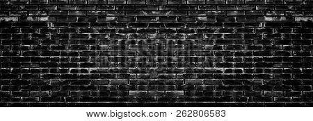 Wide Black And White Aged Brick Wall Texture. Spacious Dark Masonry. Background. Grunge Style Backgr