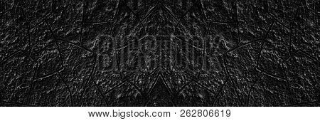 Black Plaster Wall Wide Texture. Spacious Rough Cement Surface. Dark Grunge Background