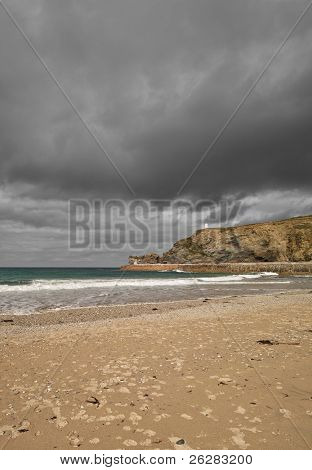 Dark clouds over Portreath beach, Cornwall UK.