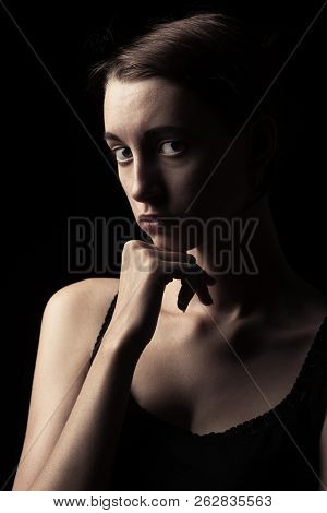 Beautiful Sad Pensive Sensual Young Woman On Black Background Looking At Camera