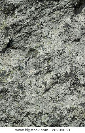 Rough dark gray granite rock texture natural background.