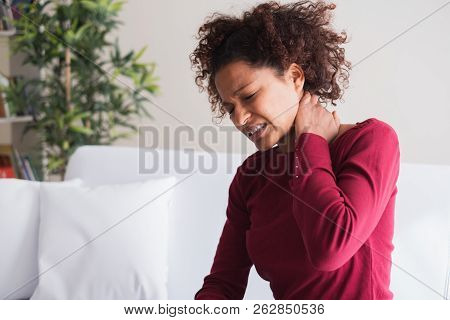 Neck Pain. Painful Woman Holds With Hand Her Neck