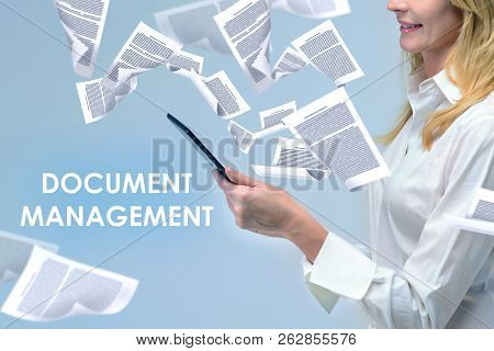 Side View Of Unrecognizable Blonde Businesswoman Looking At Her Tablet Computer Standing In Document