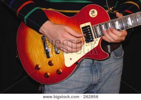 Close Up Playing Guitar