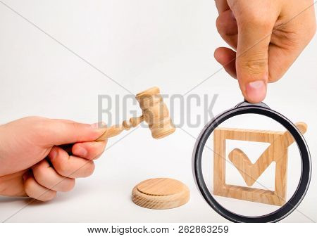 A Wooden Checkmark And A Hammer Of The Judge On A White Background. Appointment Of A Judge, Election