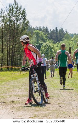 Anyksciai, Lithuania - May 24, 2014: Competition In Progress. Cyclist Girl Looking Back On The Track