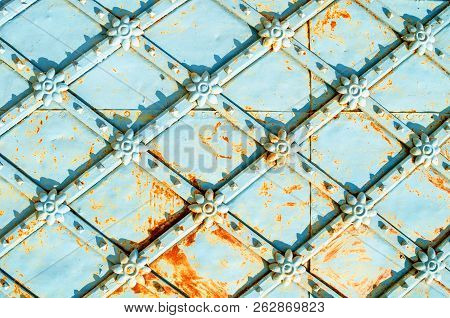 Metal architecture vintage background. Vintage metal brown surface with rusty architectural details in form of flowers