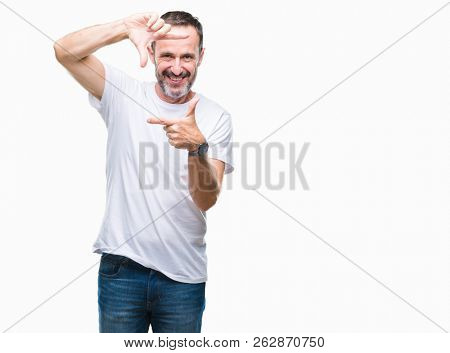 Middle age hoary senior man wearing white t-shirt over isolated background smiling making frame with hands and fingers with happy face. Creativity and photography concept.