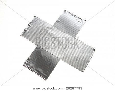 Duct tape in the form of a x and isolated on white background